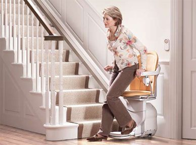 woman getting off a stairlift